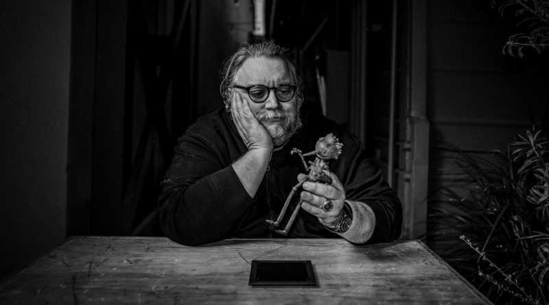 Del Toro with a Pinocchio doll