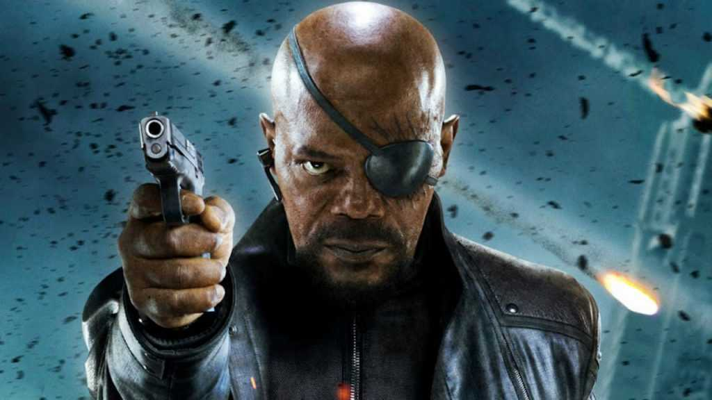 Samuel L Jackson as Nick Fury holding a gun