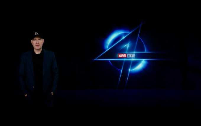 Marvel President Kevin Feige stands in front of a new Fantastic Four logo